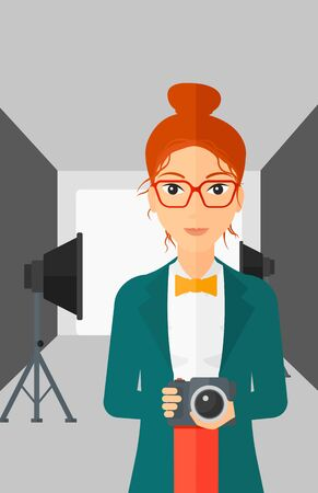 lighting equipment: A woman holding a camera on the background of photo studio with lighting equipment vector flat design illustration. Vertical layout.