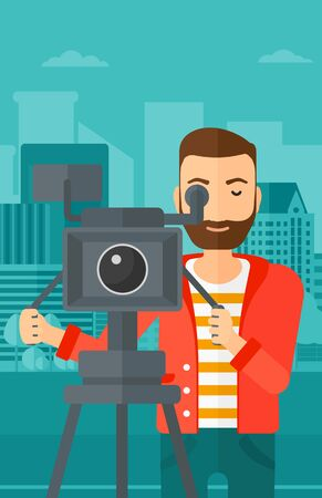 cinematographer: A hipster cameraman with the beard looking through movie camera on a city background vector flat design illustration. Vertical layout. Illustration
