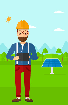 e book device: A hipster man with the beard in hardhat holding a tablet computer in hands on a background with solar pannels vector flat design illustration. Vertical layout.