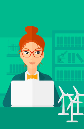 A woman sitting at the table with a laptop and wind turbine models vector flat design illustration. Vertical layout. Illustration