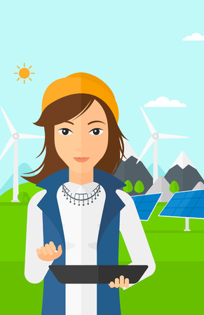 e book device: A woman holding a tablet computer in hands on a background with solar pannels and wind turbins vector flat design illustration. Vertical layout.