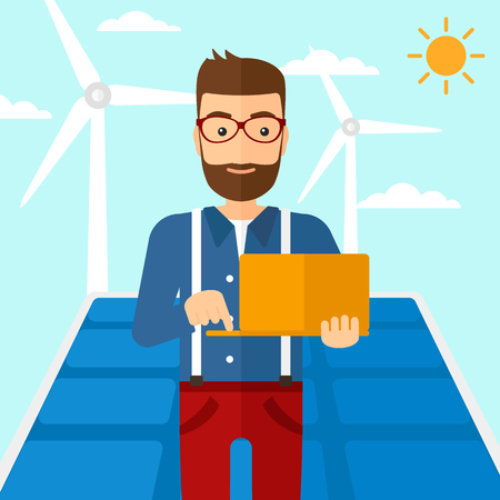 cartoon wind: A hipster man with the beard holding a laptop in hands on a background with solar pannels and wind turbins vector flat design illustration. Square layout.