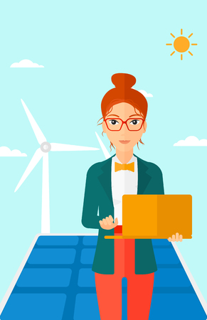 cartoon wind: A woman holding a laptop in hands on a background with solar pannels and wind turbins vector flat design illustration. Vertical layout. Illustration