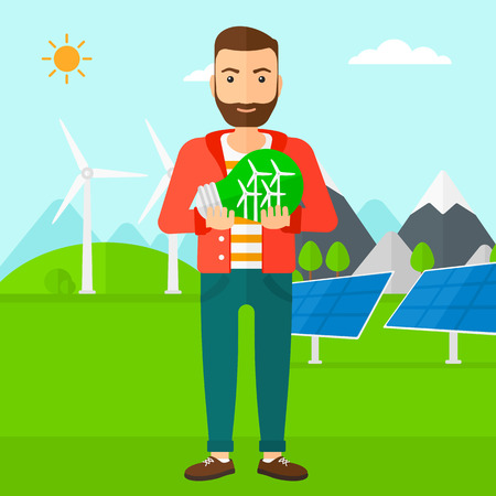 man power: A hipster man with the beard standing on a background with solar pannels and wind turbins and holding in hands a big light bulb with small wind turbines inside vector flat design illustration. Square layout.