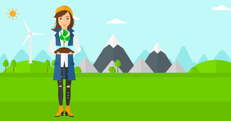 A woman standing on a background with wind turbins and holding in hands a plastic bottle with a small plant growing inside vector flat design illustration. Horizontal layout. Vettoriali