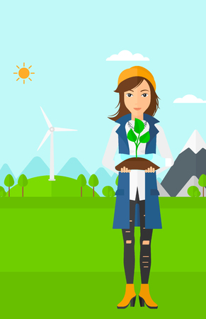 small plant: A woman standing on a background with wind turbins and holding in hands a plastic bottle with a small plant growing inside vector flat design illustration. Vertical layout.
