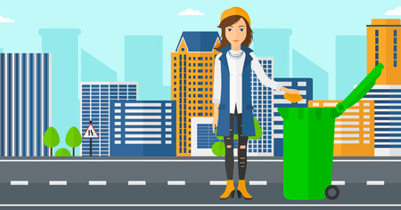 A woman throwing a trash into a green bin on a city background vector flat design illustration. Horizontal layout. Stock Illustratie