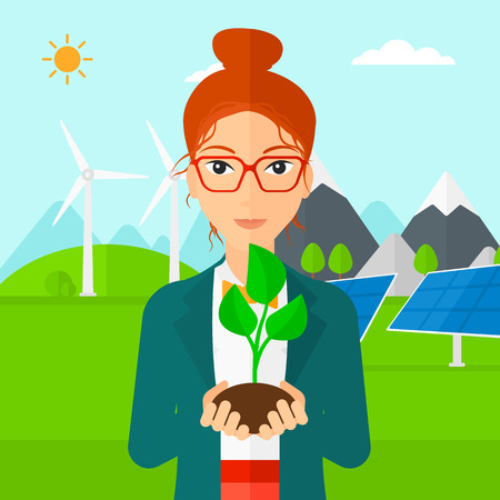 hands holding plant: Young woman holding in hands a small plant in soil on a background with solar pannels and wind turbins vector flat design illustration. Square layout.