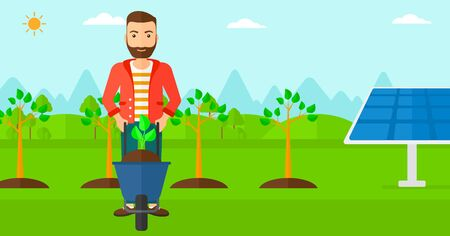 A hipster man with the beard standing with a plant and soil in a wheelbarrow on a background with newly planted trees and solar panels vector flat design illustration. Horizontal layout.