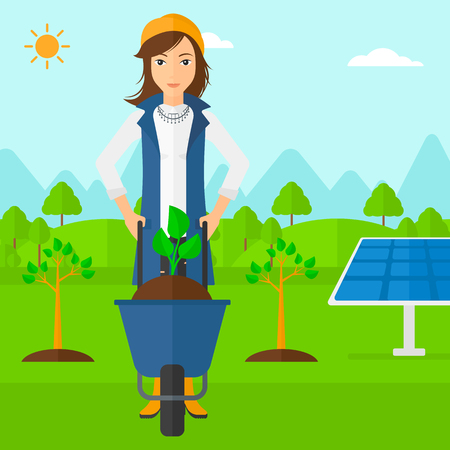 A woman standing with a plant and soil in a wheelbarrow on a background with newly planted trees and solar panels vector flat design illustration. Square layout.