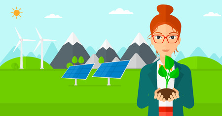 hands holding plant: Young woman holding in hands a small plant in soil on a background with solar pannels and wind turbins vector flat design illustration. Horizontal layout.