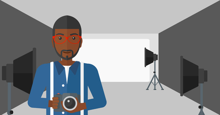 lighting equipment: An african-american man holding a camera on the background of photo studio with lighting equipment vector flat design illustration. Horizontal layout. Illustration