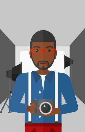 lighting equipment: An african-american man holding a camera on the background of photo studio with lighting equipment vector flat design illustration. Vertical layout.