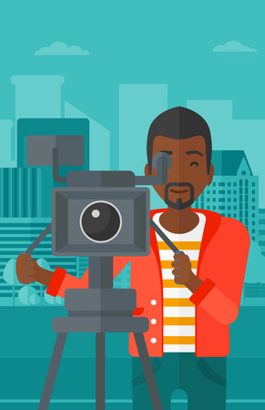 cinematographer: An african-american cameraman looking through movie camera on a city background vector flat design illustration. Vertical layout. Illustration