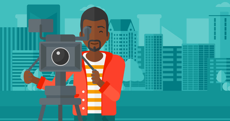 An african-american cameraman looking through movie camera on a city background vector flat design illustration. Horizontal layout.