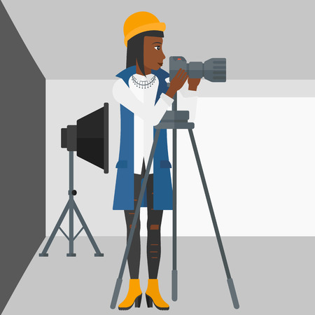 lighting equipment: An african-american woman working with camera on the background of photo studio with lighting equipment vector flat design illustration. Square layout.