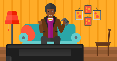 An african-american man with gamepad in hands sitting on a sofa in living room vector flat design illustration. Horizontal layout. 矢量图像