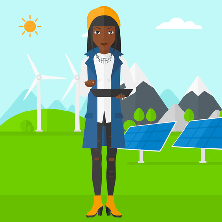 e book device: An african-american woman holding a tablet computer in hands on a background with solar pannels and wind turbins vector flat design illustration. Square layout.