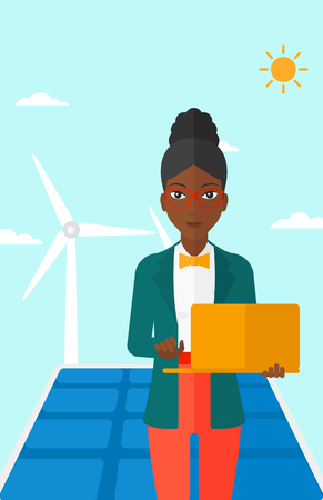 cartoon wind: An african-american woman holding a laptop in hands on a background with solar pannels and wind turbins vector flat design illustration. Vertical layout. Illustration
