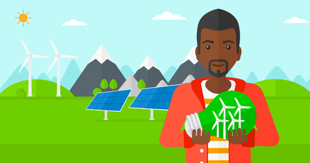 save environment: An african-american man standing on a background with solar pannels and wind turbins and holding in hands a big light bulb with small wind turbines inside vector flat design illustration. Horizontal layout.