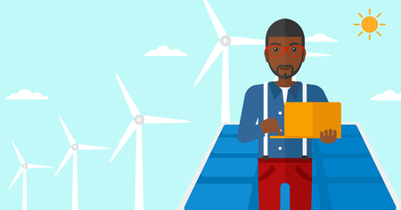 cartoon wind: An african-american man holding a laptop in hands on a background with solar pannels and wind turbins vector flat design illustration. Horizontal layout. Illustration