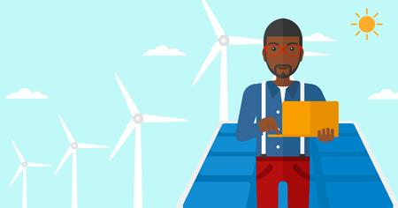 obrero caricatura: Un hombre afroamericano que sostiene un ordenador port�til en las manos sobre un fondo con paneles solares y el viento turbins ilustraci�n vectorial dise�o plano. disposici�n horizontal.