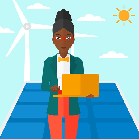 cartoon wind: An african-american woman holding a laptop in hands on a background with solar pannels and wind turbins vector flat design illustration. Square layout.