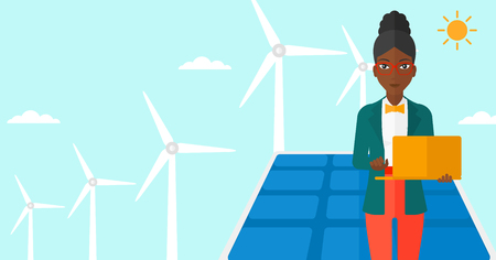 cartoon wind: An african-american woman holding a laptop in hands on a background with solar pannels and wind turbins vector flat design illustration. Horizontal layout. Illustration