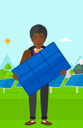 cartoon hands: An african-american man holding a solar panel in hands on a background with solar panels vector flat design illustration. Vertical layout.