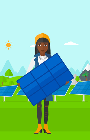 cartoon hands: An african-american woman holding a solar panel in hands on a background with solar panels vector flat design illustration. Vertical layout. Illustration