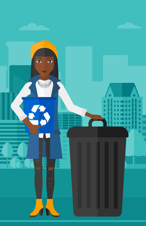 An african-american  woman standing with a recycle bin in hand and another bin on the ground on a city background vector flat design illustration. Vertical layout. Illustration