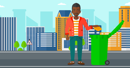 backgrounds trees: An african-american man throwing a trash into a green bin on a city background vector flat design illustration. Horizontal layout.