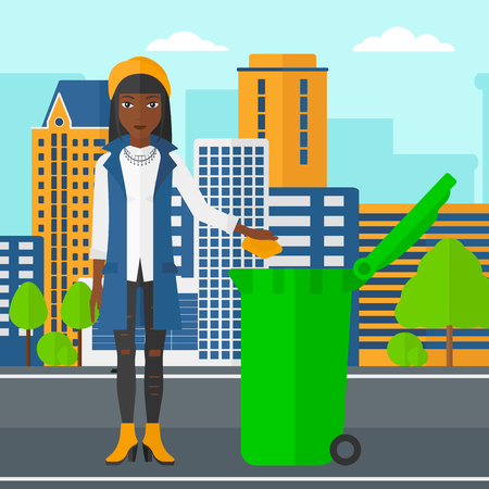 throwing: An african-american woman throwing a trash into a green bin on a city background vector flat design illustration. Square layout. Illustration