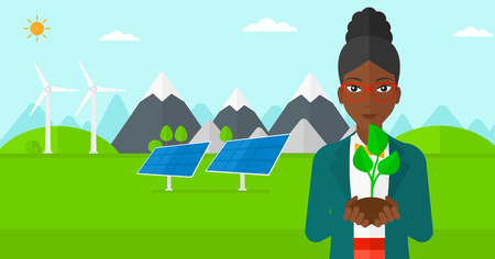 An african-american woman holding in hands a small plant in soil on a background with solar pannels and wind turbins vector flat design illustration. Horizontal layout.