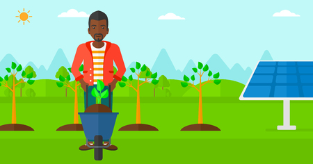 cartoon earth: An african-american man standing with a plant and soil in a wheelbarrow on a background with newly planted trees and solar panels vector flat design illustration. Horizontal layout.