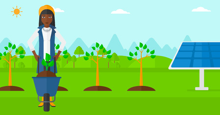 An african-american woman standing with a plant and soil in a wheelbarrow on a background with newly planted trees and solar panels vector flat design illustration. Horizontal layout.