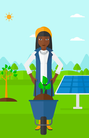 planted: An african-american woman standing with a plant and soil in a wheelbarrow on a background with newly planted trees and solar panels vector flat design illustration. Vertical layout.