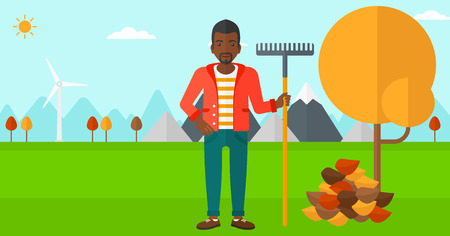 An african-american man with rake standing near tree and heap of autumn leaves vector flat design illustration. Horizontal layout.