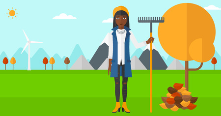 An african-american woman with rake standing near tree and heap of autumn leaves vector flat design illustration. Horizontal layout.