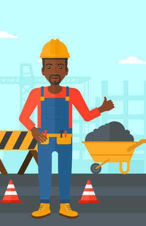 An african-american man in helmet showing thumbs up sign on a background of construction site with road barriers and wheelbarrow vector flat design illustration. Vertical layout.
