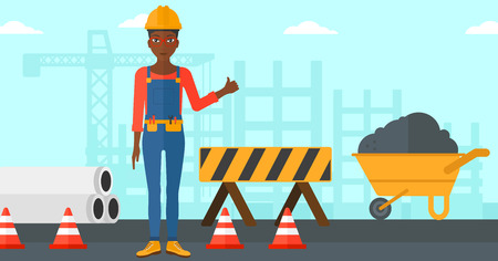 An african-american woman in helmet showing thumbs up sign on a background of construction site with road barriers and wheelbarrow vector flat design illustration. Horizontal layout.