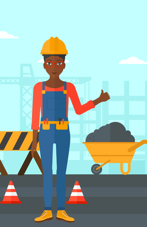 construction equipment: An african-american woman in helmet showing thumbs up sign on a background of construction site with road barriers and wheelbarrow vector flat design illustration. Vertical layout. Illustration