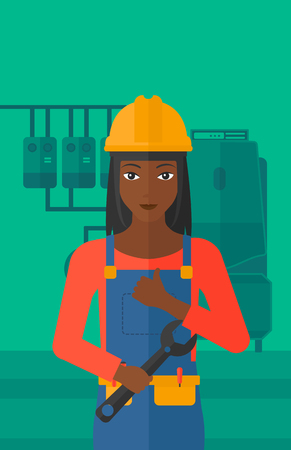 fitter: An african-american female repairer engineer with a spanner in hand showing thumb up sign on a background of domestic household boiler room with heating system and pipes vector flat design illustration. Vertical layout.