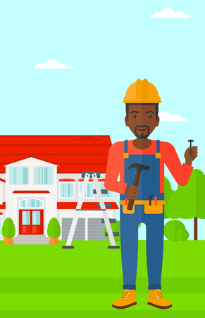 building contractor cartoon: An african-american man in helmet with a hummer and a nail in hands standing on a house background vector flat design illustration. Vertical layout.