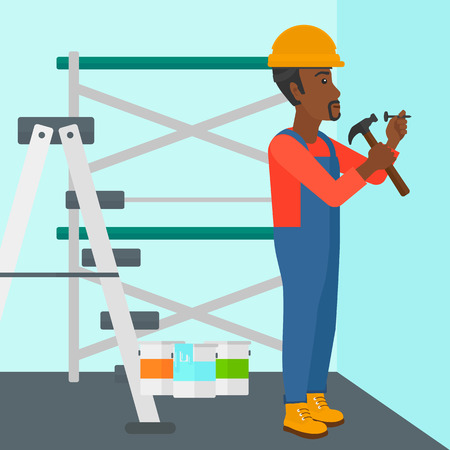 paint cans: An african-american man hitting a nail in the wall with a hummer on a background of room with paint cans and ladder vector flat design illustration. Square layout. Illustration