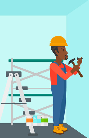 An african-american man hitting a nail in the wall with a hummer on a background of room with paint cans and ladder vector flat design illustration. Vertical layout.