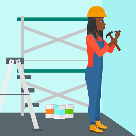 An african-american woman hitting a nail in the wall with a hummer on a background of room with paint cans and ladder vector flat design illustration. Square layout.