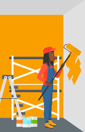 house painter: An african-american woman painting walls with a paint roller vector flat design illustration. Vertical layout.