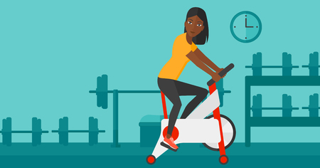 stationary bicycle: An african-american woman exercising on stationary training bicycle in the gym vector flat design illustration. Horizontal layout.