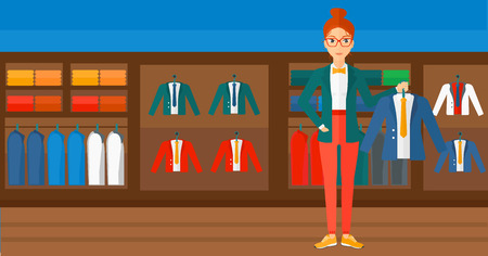 choosing clothes: A woman holding a hanger with a jacket on the background of clothes store vector flat design illustration. Horizontal layout.